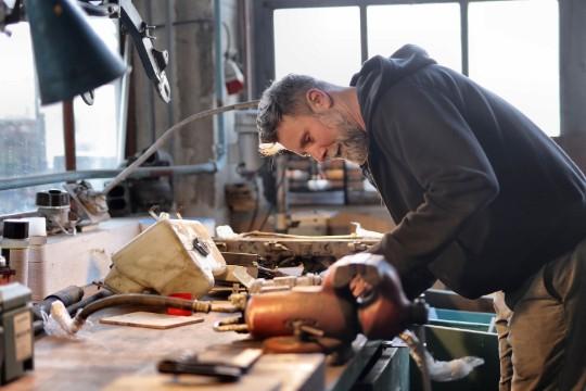 carpenter working hard in the workshop at townsville handyman