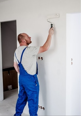 painter painting walls white at townsville handyman